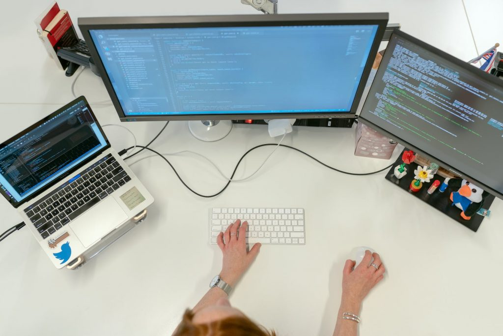 female software engineer coding on computer
